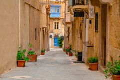 Valletta, Malta - The traditional houses. Narrow streets and walls of Valletta, the capital city of Malta on an early summer morning before sunrise Stock Photos