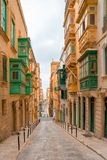 Valletta, Malta - The traditional houses. Narrow streets and walls of Valletta, the capital city of Malta on an early summer morning before sunrise Royalty Free Stock Photos