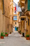 Valletta, Malta - The traditional houses. Narrow streets and walls of Valletta, the capital city of Malta on an early summer morning before sunrise Royalty Free Stock Photo