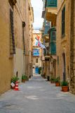 Valletta, Malta - The traditional houses. Narrow streets and walls of Valletta, the capital city of Malta on an early summer morning before sunrise Royalty Free Stock Image