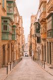 Valletta, Malta - The traditional houses. Narrow streets and walls of Valletta, the capital city of Malta on an early summer morning before sunrise Stock Photo