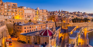 Valletta, Malta - The traditional houses and walls of Valletta. The capital city of Malta on an early summer morning before sunrise with clear blue sky Stock Images
