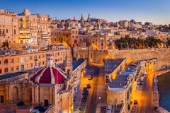 Valletta, Malta - The traditional houses and walls of Valletta, the capital city of Malta. On an early summer morning before sunrise with clear blue sky Royalty Free Stock Photos