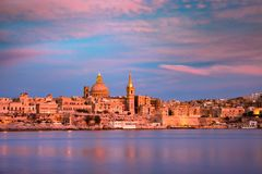 Valletta Skyline from Sliema at sunset, Malta. Valletta Skyline at beautiful sunset from Sliema with churches of Our Lady of Mount Carmel and St. Paul`s Anglican Royalty Free Stock Photography