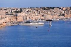 Valletta Skyline with luxury super yacht. Valletta Skyline, port and superyacht at summer day Royalty Free Stock Image