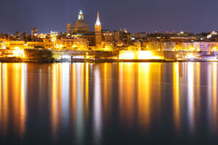 Valletta Skyline from Sliema at night, Malta. Valletta Skyline at night from Sliema with church of Our Lady of Mount Carmel and St. Paul`s Anglican Pro-Cathedral Royalty Free Stock Photos