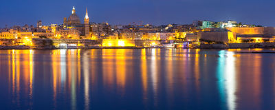 Valletta Skyline from Sliema at night, Malta. Valletta Skyline at night with church of Our Lady of Mount Carmel and St. Paul`s Anglican Pro-Cathedral, Valletta Royalty Free Stock Photo