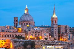 Valletta Skyline from Sliema at night, Malta. Valletta Skyline from Sliema with church of Our Lady of Mount Carmel and St. Paul`s Anglican Pro-Cathedral during Stock Photography