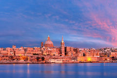 Valletta Skyline from Sliema at sunset, Malta. Valletta Skylineat at beautiful sunset from Sliema with churches of Our Lady of Mount Carmel and St. Paul`s Stock Images