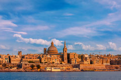 Valletta Skyline from Sliema at sunset, Malta. Valletta Skylineat at beautiful sunset from Sliema with churches of Our Lady of Mount Carmel and St. Paul`s Stock Image