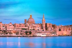 Valletta Skyline from Sliema at sunset, Malta. Valletta Skyline at beautiful sunset from Sliema with churches of Our Lady of Mount Carmel and St. Paul`s Anglican Royalty Free Stock Photo