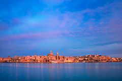 Valletta Skyline from Sliema at sunset, Malta. Valletta Skyline at beautiful sunset from Sliema with churches of Our Lady of Mount Carmel and St. Paul`s Anglican Royalty Free Stock Images