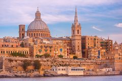 Valletta Skyline from Sliema at sunset, Malta. Valletta Skyline with ship at beautiful sunset from Sliema with churches of Our Lady of Mount Carmel and St. Paul` Royalty Free Stock Photos