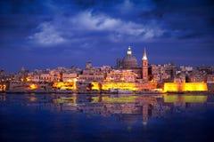 Valletta Skyline at Sunset, Malta. City of Valletta Malta at Sunset captured from Silema Bay Royalty Free Stock Images