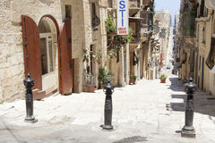 Valletta street, Malta. A typical Maltese street in the old town of Valletta, Malta Royalty Free Stock Photography