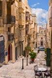 Valletta street. One of the many sloping streets of Valletta in Malta Stock Photos