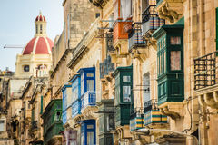 Valletta street with traditional colorful balconies Stock Image