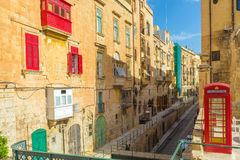 Valletta streetview with red balconies and phone booth - Malta Royalty Free Stock Photos