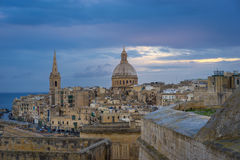 Valletta at sunrise, Malta. Valletta in the morning with Basilica and St. Paul`s Anglican Cathedral, Malta Royalty Free Stock Image