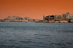 Valletta sunset. A magic sunrise on the historic port of la valletta on malta island Stock Photography
