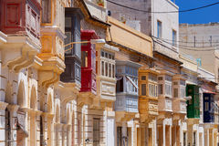 Valletta. Traditional balconies on the facades of houses. Multicolored traditional balconies on the facades of stone houses. Valletta. Malta Stock Image