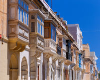 Valletta. Traditional balconies on the facades of houses. Multicolored traditional balconies on the facades of stone houses. Valletta. Malta Royalty Free Stock Image