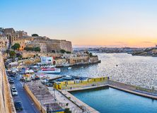 Valletta Water Polo Club, Malta. VALLETTA, MALTA - JUNE 17, 2018: The pool of Water Polo Club surrounded by waters of Marsamxett Harbour with ferry terminal and Royalty Free Stock Image