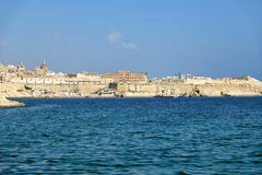 Valletta waterfront as seen from Kalkara peninsula over the Gran. The view of Valletta city over the water of Grand harbor. Malta Stock Photography