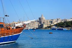 Valletta waterfront and harbour, Malta. Yacht moored along the quayside with views across the Grand Harbour towards Valletta, Sliema, Malta, Europe Royalty Free Stock Images