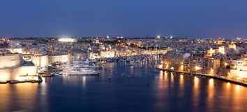 Valletta Waterfront. A view from the Valletta waterfront to the Fort Saint Angelo and marina at night Royalty Free Stock Image