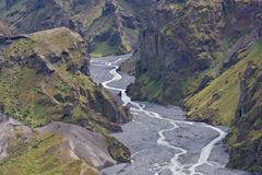 Valley. A valley with a small river running through amidst rough rocks. Iceland Royalty Free Stock Photos
