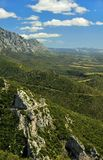 Valley from above and small winding road. View from above of a valley in the Cathar country, France, with a small winding road Stock Image