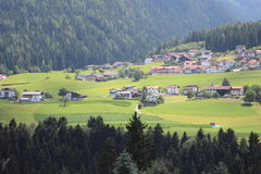 Valley in the Alps with small village Stock Photography