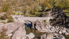 Valley autumn river bridge rocks Ticino Switzerland Aerial 4k
