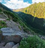 Valley of the balea stream in fagaras mountains. View from the rocky cliff on a steep slope. forested hillside in the distance. popular travel destination of stock photos