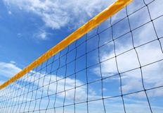Valley ball net, blue sky. Yellow valley ball net, blue sky Royalty Free Stock Photography