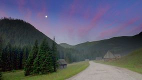 Valley Chocholowska before dawn with full moon, Tatra Mountains stock footage