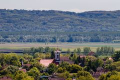 Valley with a church, valley with a village aerial take royalty free stock photo