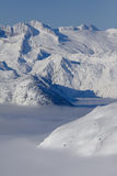 Aneto peak and Aran valley covered with fog. The lower part of Aran Valley is covered with a deep fog. The highest peak of pyrenees is Aneto, on top of the range Stock Photography