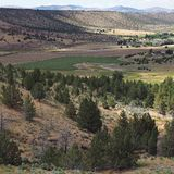Valley down below. A view down hills into the farming valley and the small rural community of Gateway in Central Oregon on a sunny summer  day royalty free stock images