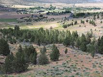 Valley down below. A view down hills into the farming valley and the small rural community of Gateway in Central Oregon on a sunny summer  day royalty free stock photos