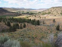 Valley down below. A view down hills into the farming valley and the small rural community of Gateway in Central Oregon on a sunny summer  day royalty free stock image