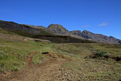 The Valley of Elves in Iceland with hills and caves. The Valley of Elves in Iceland hills and shallow caves Royalty Free Stock Images
