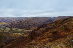 The valley on fall grassland Royalty Free Stock Image
