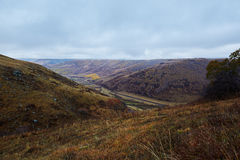 The valley on fall meadows Royalty Free Stock Photos