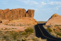 Valley of Fire. Curved road and red rocky hills in the Valley of Fire Royalty Free Stock Photos
