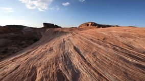 Valley of Fire POV. POV walking on Mojave desert Valley of Fire State Park, Nevada, United States. Stripes in red rock along the Fire Wave Hike at sunset light stock video footage