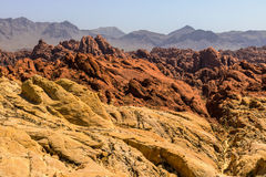 Valley of Fire State Park with 40,000 acres of bright red Aztec sandstone outcrops nestled in gray and tan limestone I Stock Image