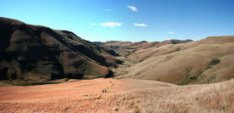 Valley at foot of Giants Castle. Drakensberg South Africa with trail down into valley with hikers Stock Image