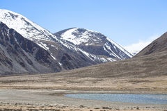 The valley at the foot of the mountains on Pamir. Spring. Tajiki Stock Photography